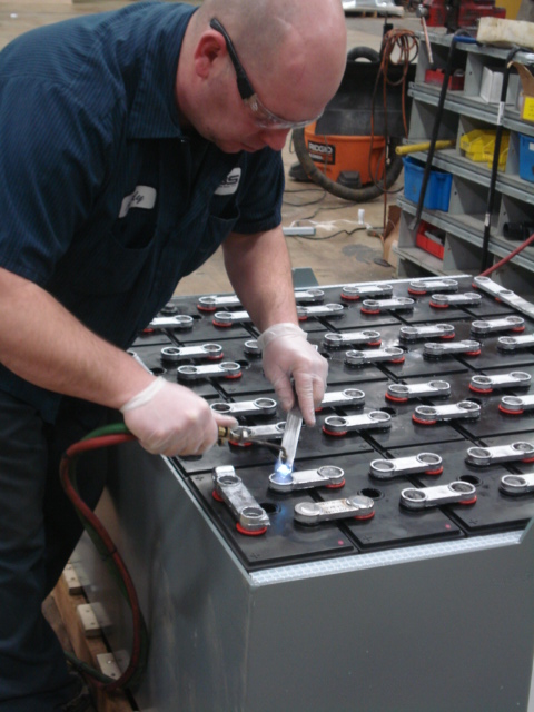 SBS worker repairing forklift battery